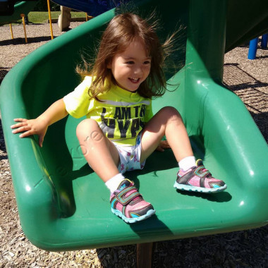 Lilly on the slide at the Vestal Rail Trail
